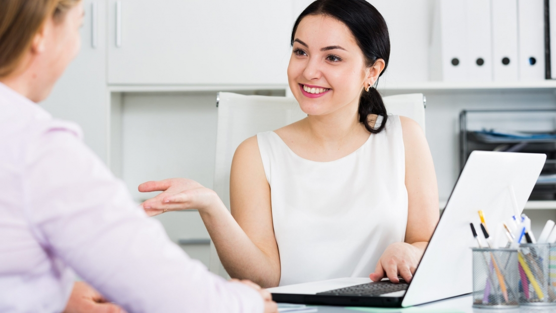Young female manager meeting woman client in office